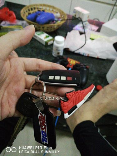 427a42569 Sneaker Keychain - ADIDAS NMD Solar Red